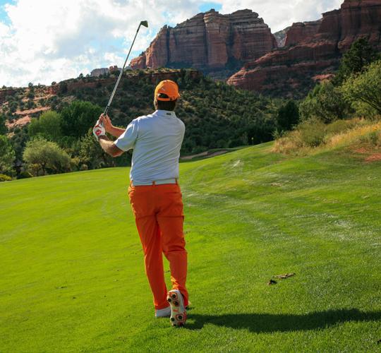 golfer swings