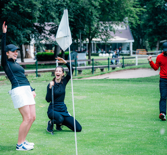 2 golfer happy made the shot